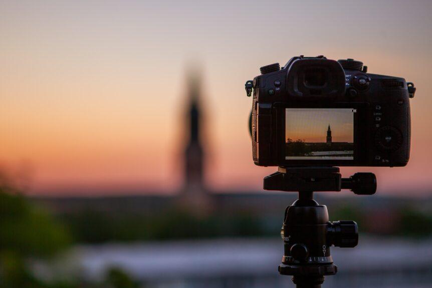 Camera on tripod Taking a photo of a church